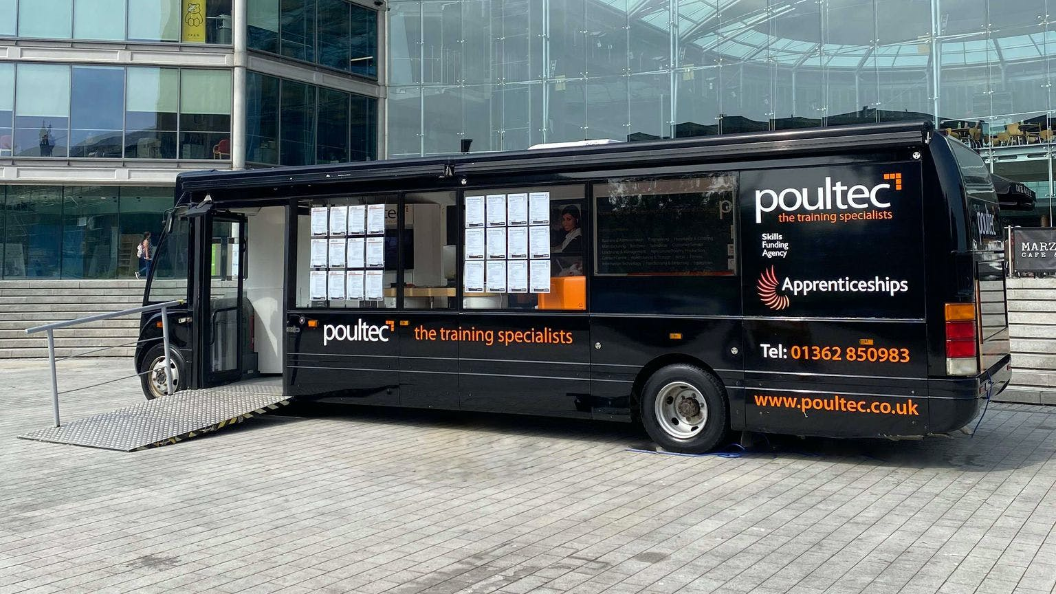 A picture of the Poultec Training bus outside The Forum, Norwich