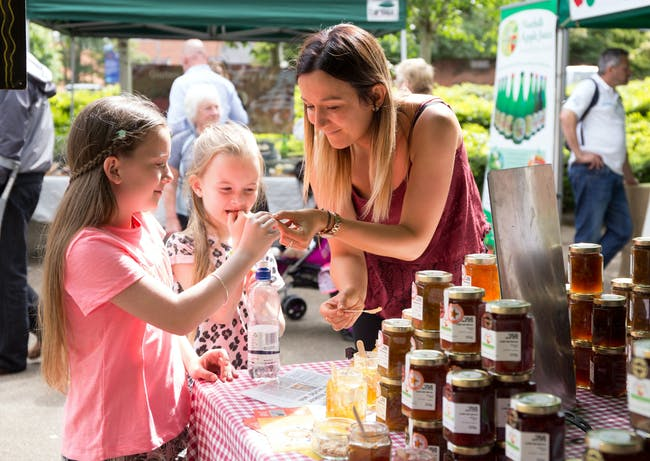 Family try chutneys at a food stall