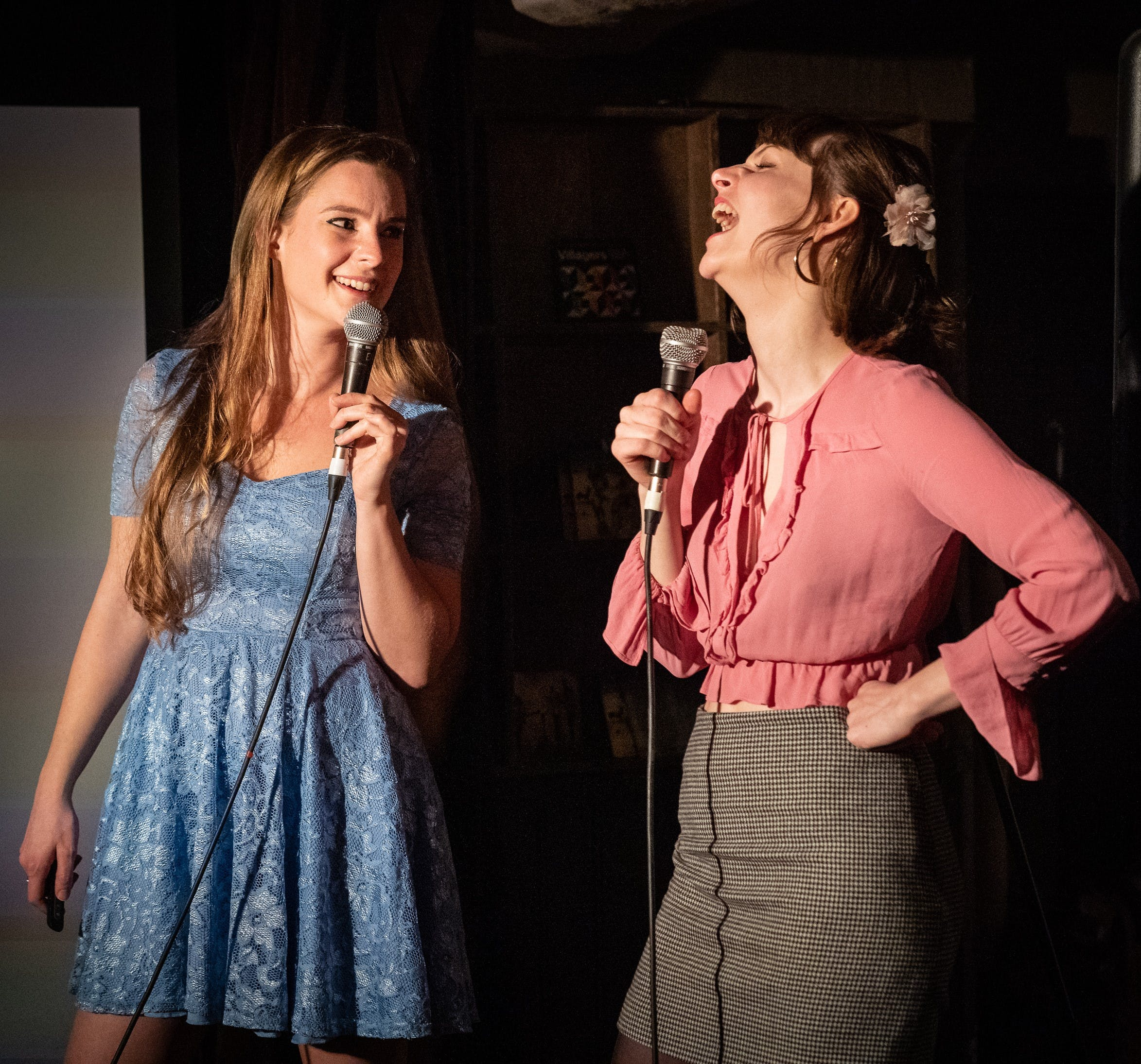 Scientists Belle Taylor and Charlotte Mykura doing a stand-up comedy show.
