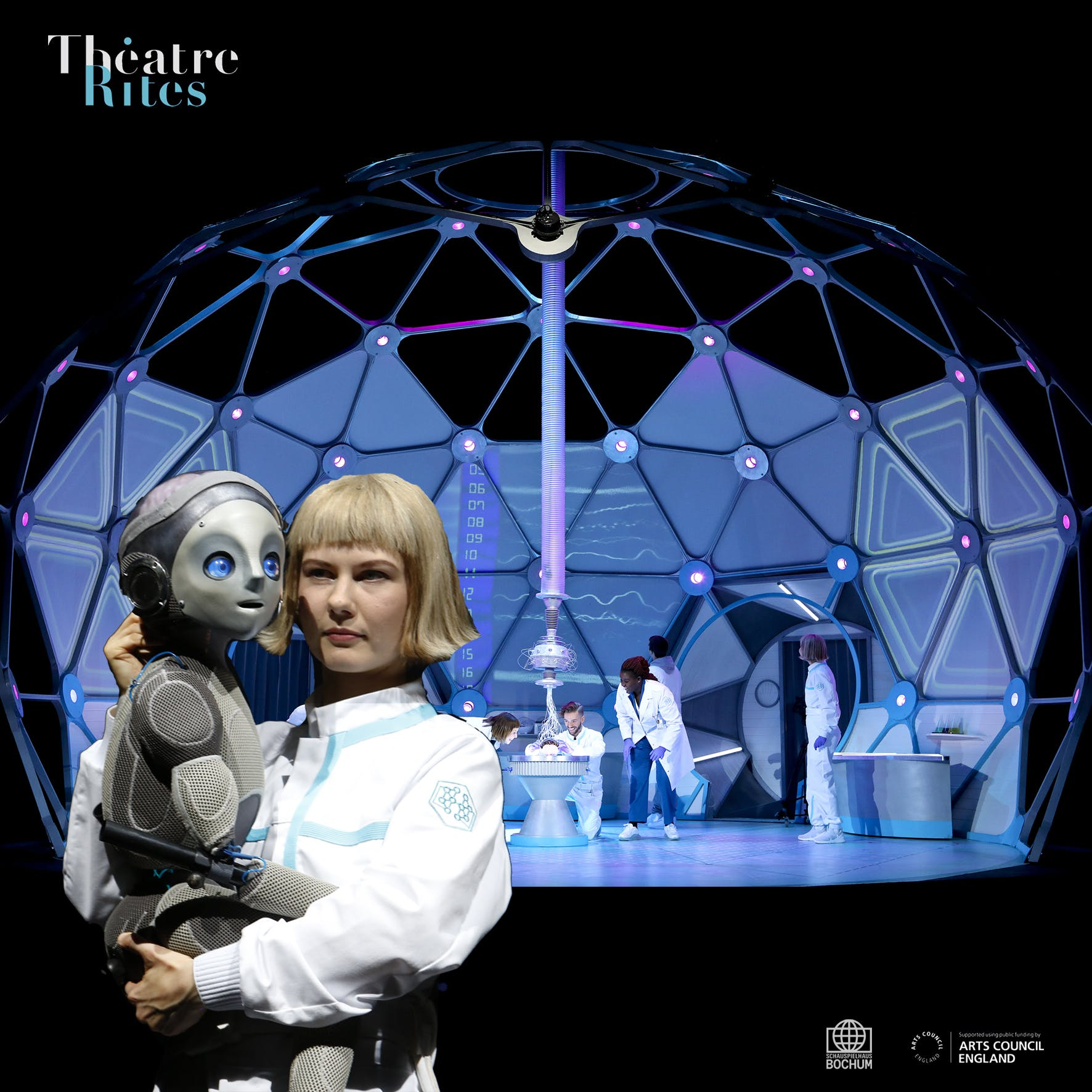Women in lab coat holding Robot Boy, a grey humanoid puppet with blue eyes.