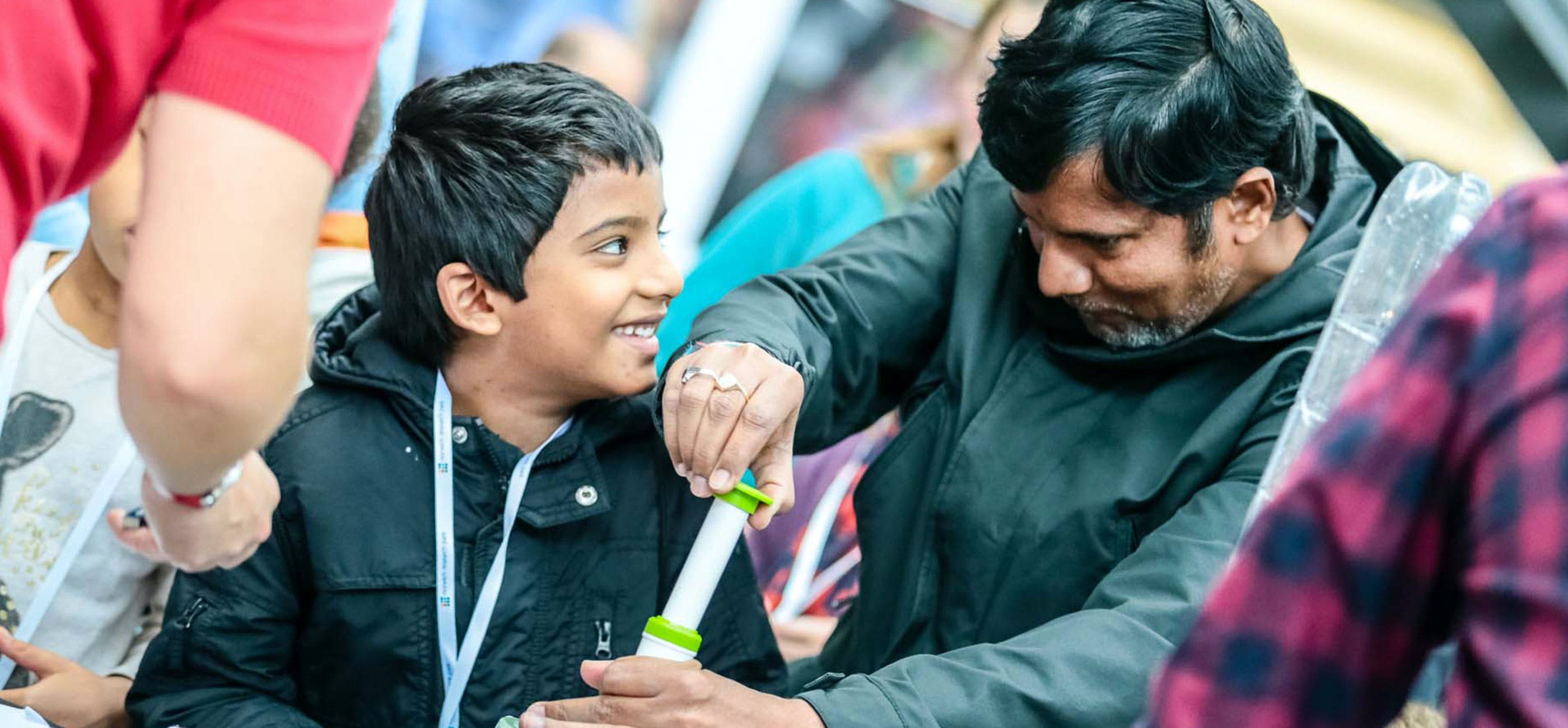 Boy and man at Norwich Science Festival 2019 - credit Mark Hewlett Photography