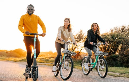 Riders in the countryside on Beryl Bikes and escooters