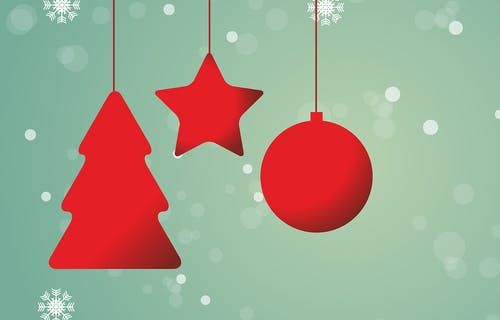 An illustration of three red baubles shaped like a Christmas tree, a star and a circle with a green background with snowflakes