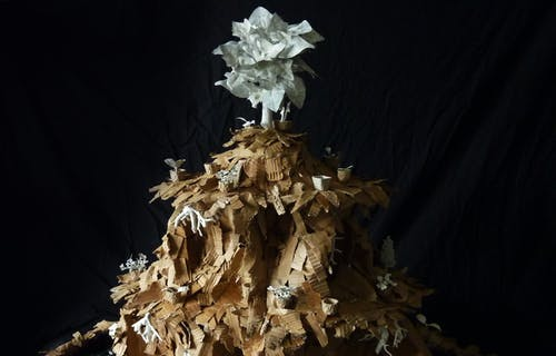 Cardboard volcano sculpture from Chris Jackson with black background