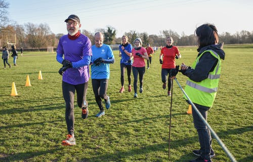 Five runners taking part in the Colney Lane parkrun, 2 male and 3 female